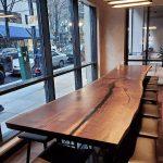 Live Edge Black Walnut 16 ft table split in 2 The Porter Hotel Portland Oregon